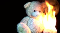 burning teddy in slow motion video