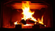Burning Wood In The Fireplace. The camera moves back to the slider video