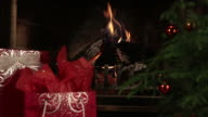 Burning Wood Inside Fireplace and Christmas Presents video