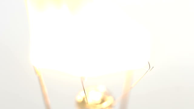 burns from a spiral light bulb, close-up shooting video