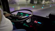 Bus driver at the wheel riding intercity coach on night road in the city video