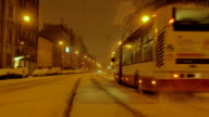 Bus rides from a snow covered bus stop, Central Europe, Night video