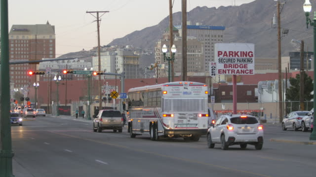 Buses Drive Through Border Town Intersection video