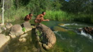 Bush people at a river video