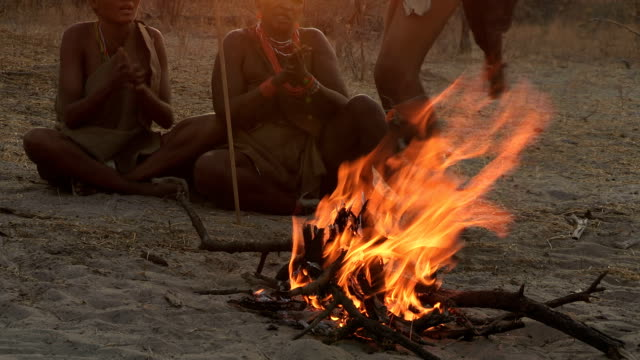 Bushmen family doing tradiitonal dance around a fire video