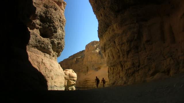 bushmen walking in canyon video