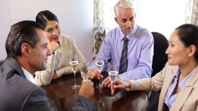 Business associates drinking wine after work video