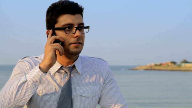 Business Beach Vacation Man Talking on Phone Work Relax Concept video