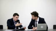 Business confrontation: Businessmen arguing in the office video