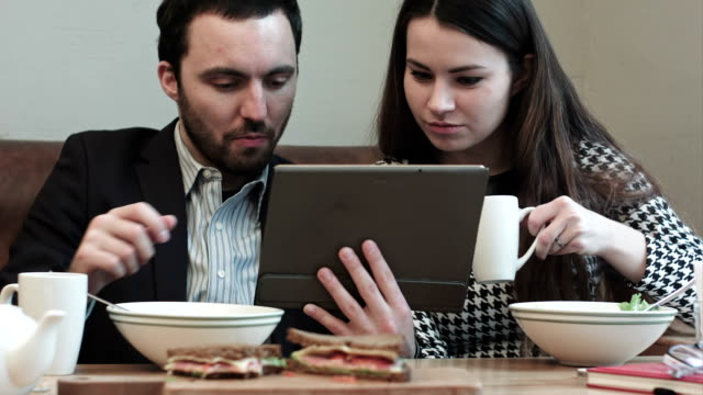 business couple at cafe use tablet video