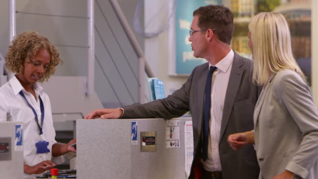 Business Couple Checking In At Airport Shot On R3D video