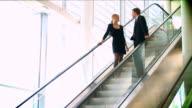 HD Business couple meeting on escalator video