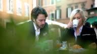 Business couple taking a break video