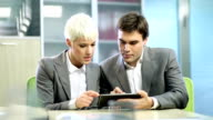 Business Couple with tablet video