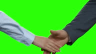 Business couple's handshake on green chromakey. video
