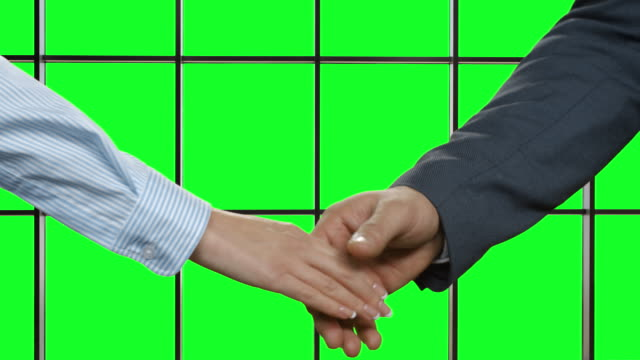 Business deal at the background of green chromakey. video