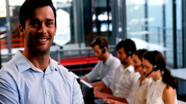 Business executive smiling in call centre video