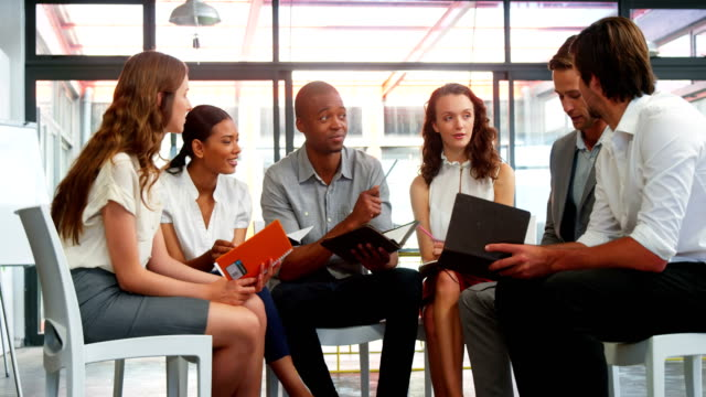 Business executives interacting with each other in meeting video