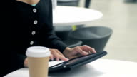 Business female working in Café on Tablet video