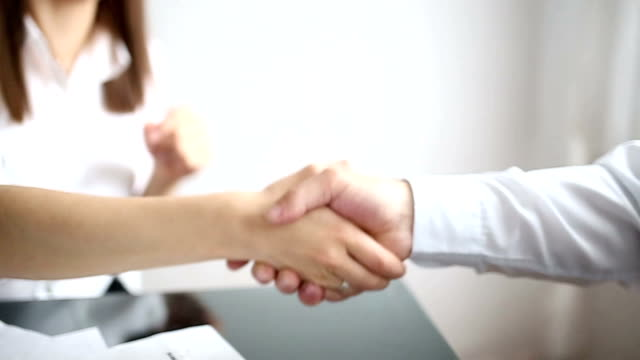 Business handshake in the office video