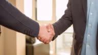 Business handshake of two men video