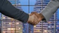 Business handshake on night city background. video