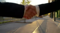 CLOSE UP: Business handshake on sunny morning video