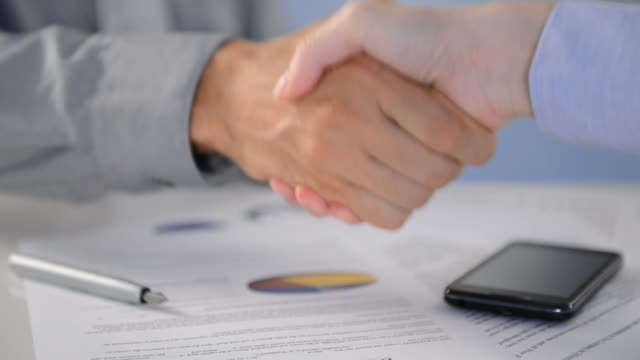 Business handshake to Seal a Deal video