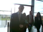 Business Leaders in large offices video