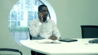 Business male on phone working in office video