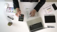 Business man analyze financial data in overhead angle video
