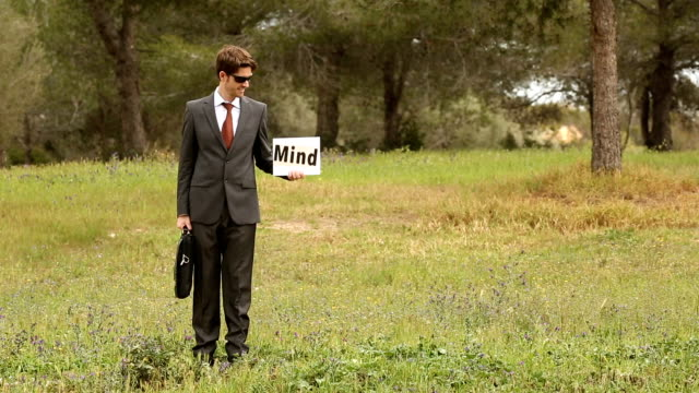 business man and two young people with self made signboard with the word puzzle mindfulness video