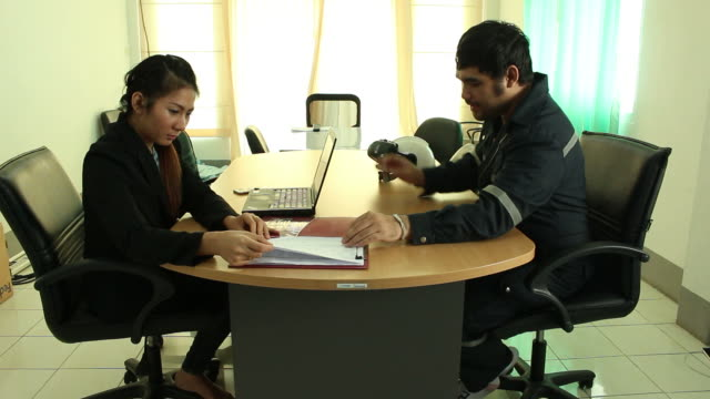 Business man and woman working in office video