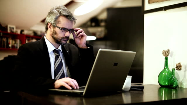 Business Man At Home Using A Laptop Computer video