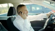 Business man calling with cell phone in car video