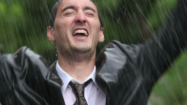 Business man celebrating in rain video