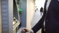 Business man credit card withdrawal at bank video