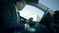 Business man driving a car in the city video