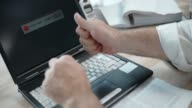 SLO MO Business man hitting his laptop video