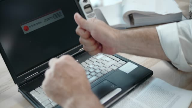 SLO MO Business man hitting his laptop video
