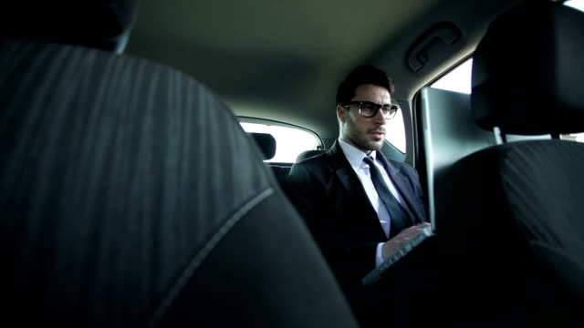 Business man in car video