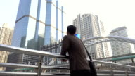 Business man looking forward to opportunity in modern city video