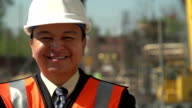 Business man on a construction site, close up video