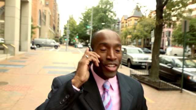 Business Man on Phone in Urban Setting video