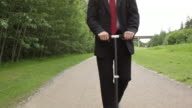 Business man rides a scooter to work video