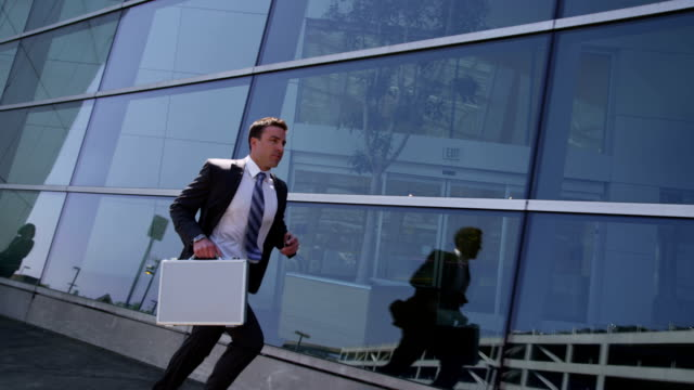 Business man running video