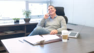 Business man talking on the phone at the office video