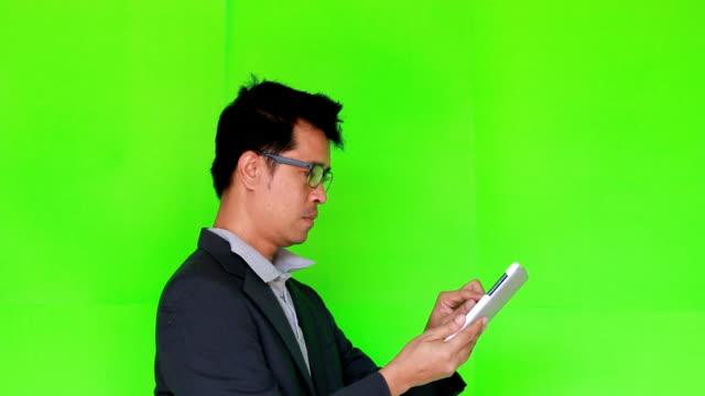 Business man touching tablet Green screen video