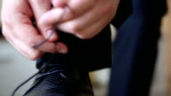 Business man tying the laces on shoes. Businessman dress shoes business. video