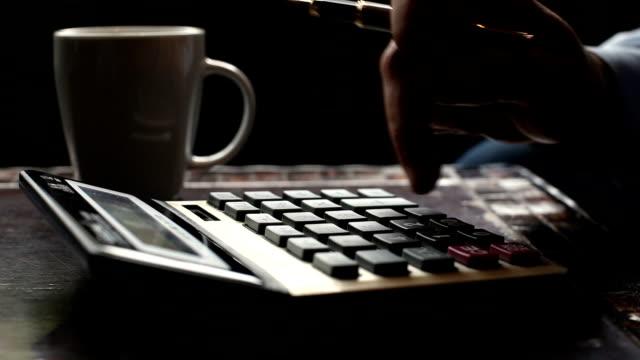 Business man typing on calculator drinking coffee, tea video